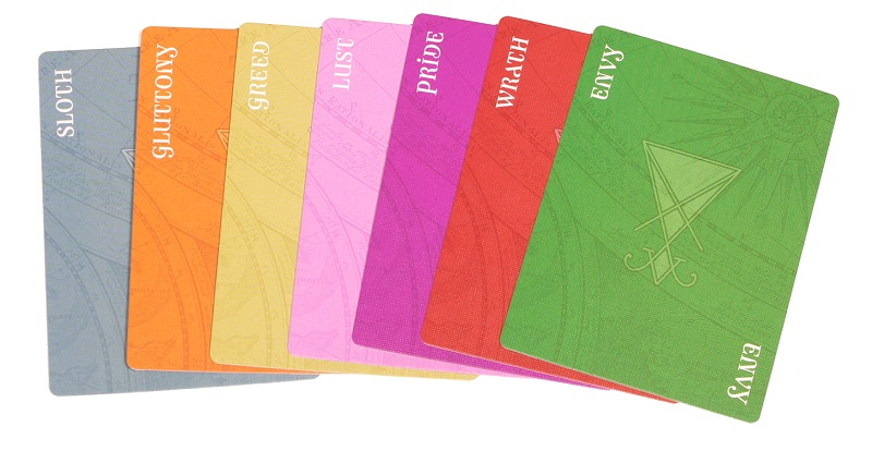 Multicolored 7 Deadly Sins cards displayed in a spread