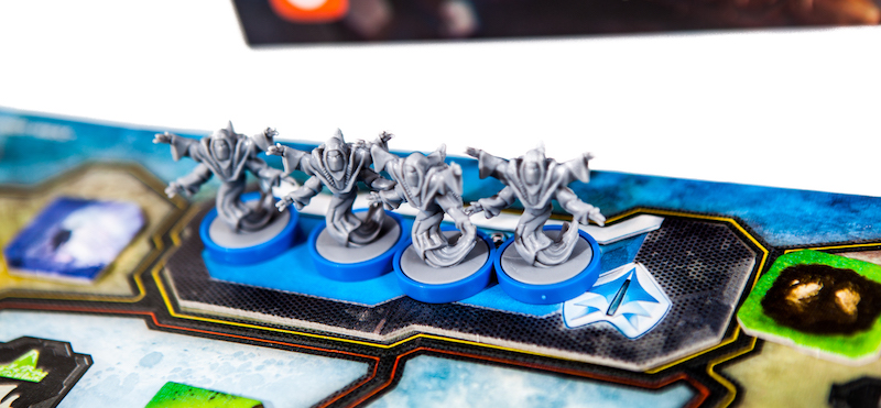 close up of blue-based game miniatures