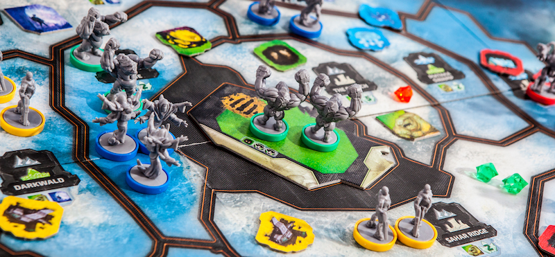 close up of blue-based game miniatures set up on game board