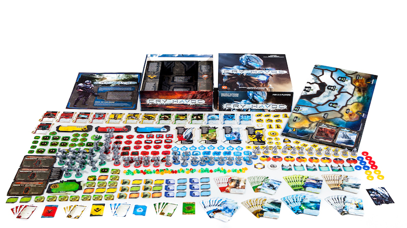 All Cry Havoc game components laid out, including board game box, miniatures, cards, game pieces, player boards, and rulebook