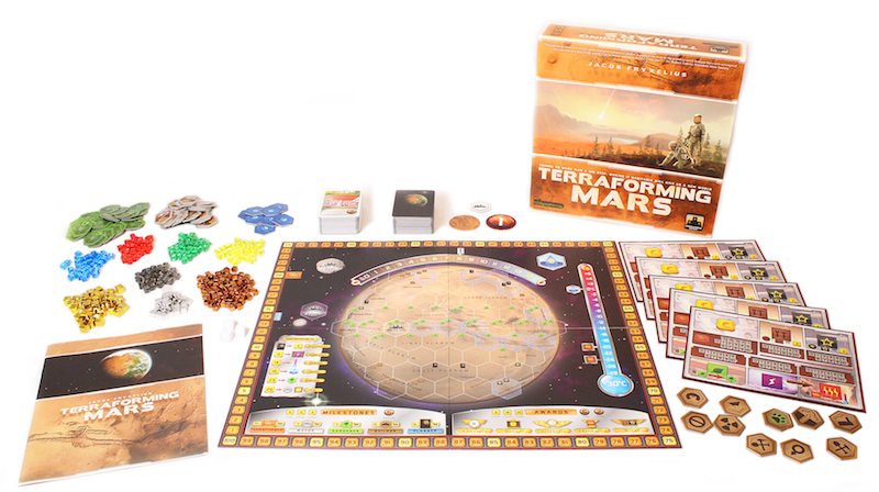 all components of Terraforming Mars game laid out, including board game box, rulebook, game tokens, player pieces, and game board