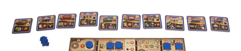 closeup of game cards, blue tokens and blue game board pieces
