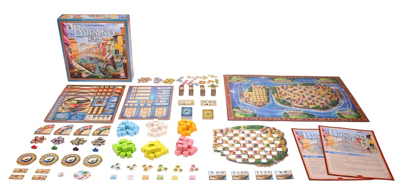 all game components laid out, including game box, rulebook, game pieces, cards and game board