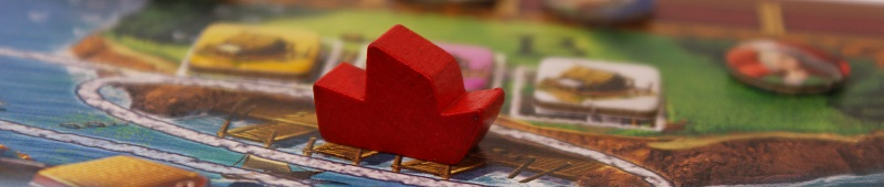 closeup of a red game piece on the game board