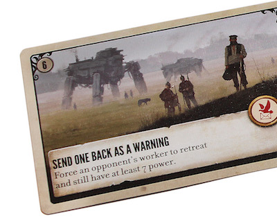 closeup of a game card reading 'Send one back as a warning', the number 6 appears at top left of the card