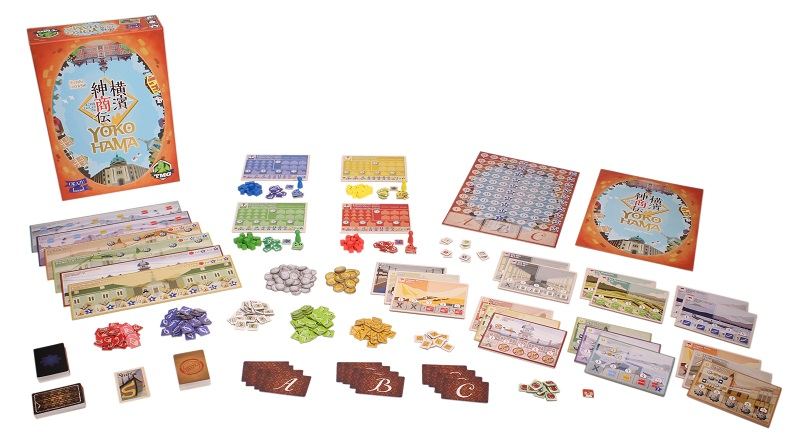 Yokohama game components laid out, including board game box, tokens, cards, player game boards, rulebook, miniatures and game board