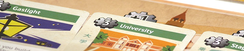 closeup of game cards, with the words 'University' and 'Gaslight'