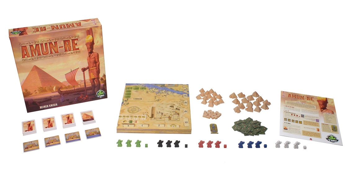 Amun-Re box, game board, wooden meeples, wooden cubes, wooden pyramids, rulebook, cards, and other components on display