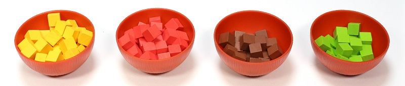 four red game piece bowls containing yellow, red, green and brown cube-shaped game pieces