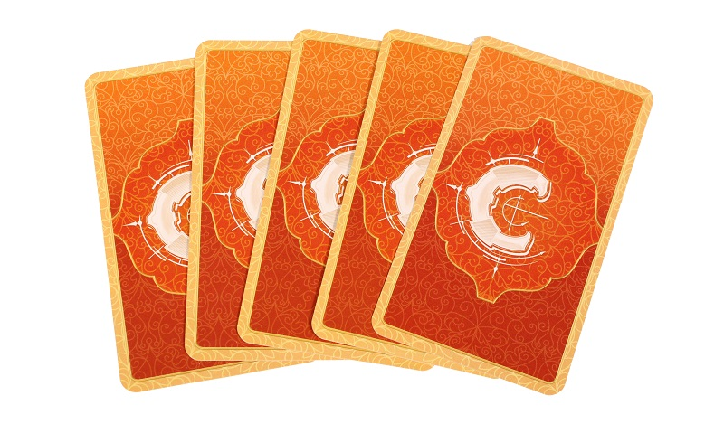 five game cards laid out in a spread, with only the cardback showing