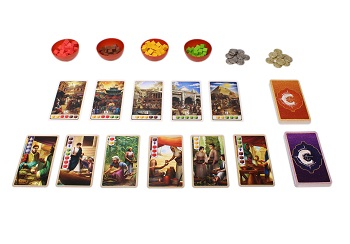 game components laid out, including four red game piece bowls containing colored game pieces, cards and tokens