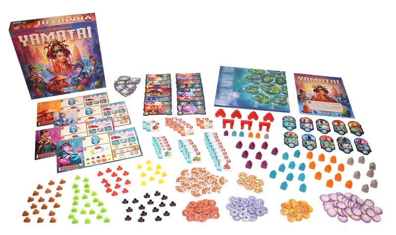 all Yamatai components laid out, including the board game box, tokens, game pieces, player boards, game board, and rulebook