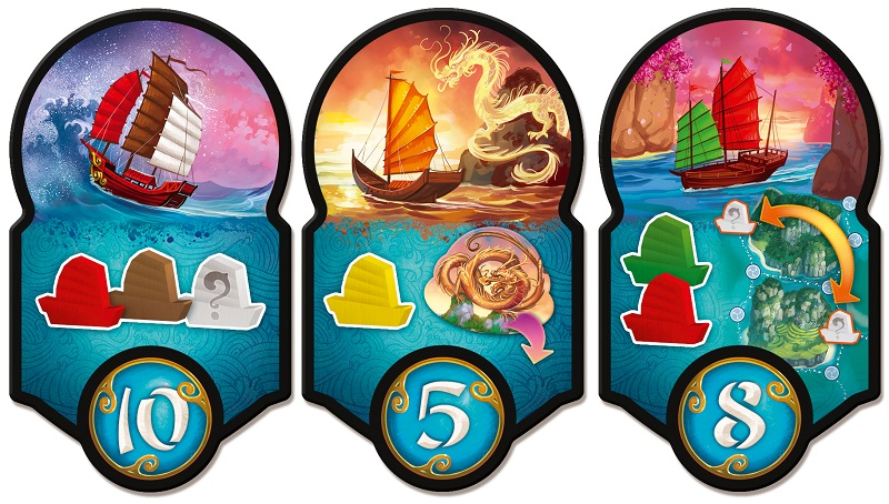 closeup of three game board tokens, all with art depicting ships sailing the seas