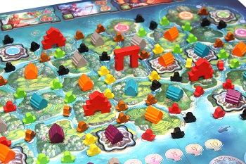closeup of game board with colorful game pieces placed upon it