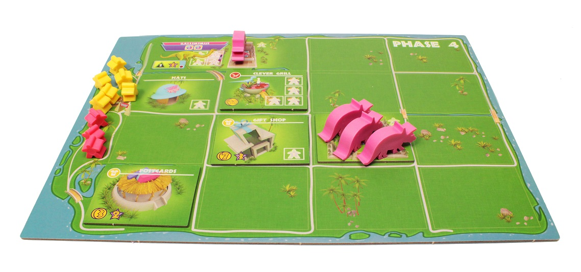 An example of a player board setup with multiple worker meeples and dinosaur figures.