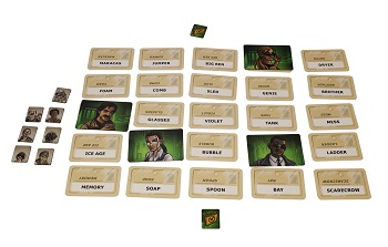 stacks of game cards and tokens, with some of the game cards flipped over, showing the cardbacks depicting a male character from the game