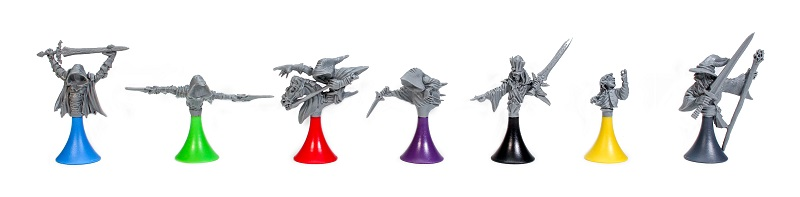 seven miniatures, each a sinister hoodedfigure atop a colored base, in the colors of blue, green, red, purple, black, yellow, and grey