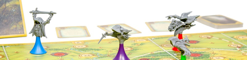 four game piece miniatures, each of a sinister figure wearing a hood; their base colors are blue, purple, red, and green