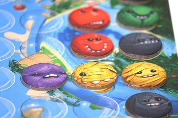 closeup of multicolored game tokens on game board