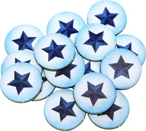 A pile of circular carboard tokens featuring a star.