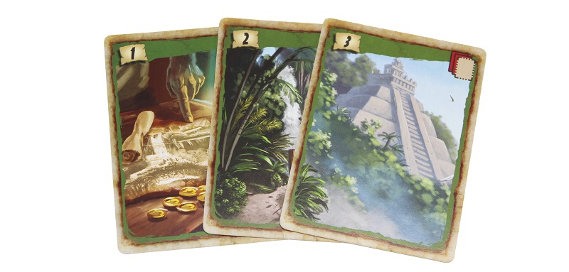 three game cards depicting locations from the game, and bearing the numbers '1', '2', and '3'