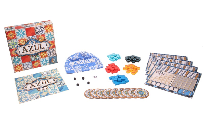 Azul game box, player board, drawstring bag, rulebook, azulejos tiles, wooden cubes, and circle tiles on display
