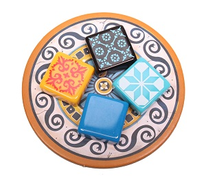 Plastic azulejos tiles on a circular punchboard tile