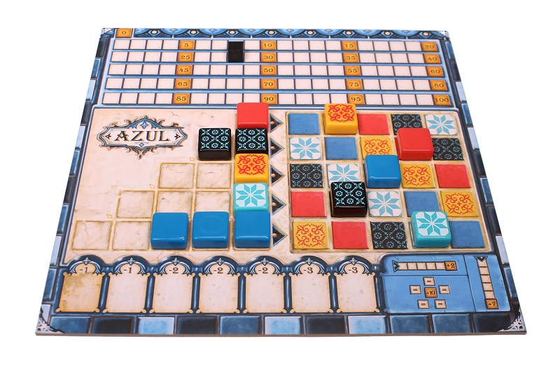Azul main board with plastic azulejos tiles and wooden cube during mid-game