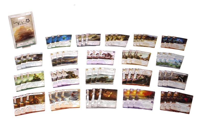 The twenty sets of three cards groups within the game, spread out next to the game's box on display