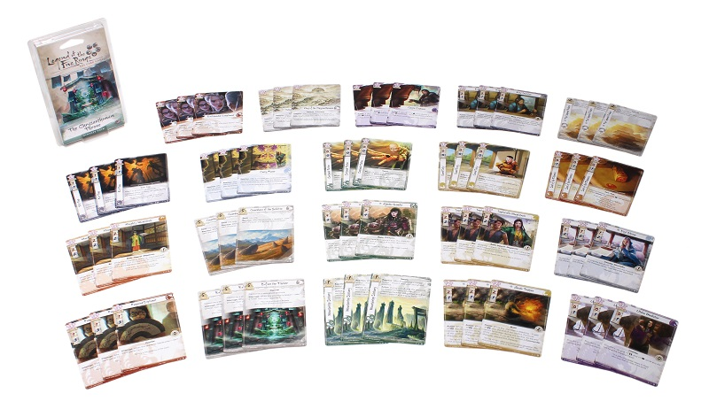 all game components laid out, including numerous sets of three cards each