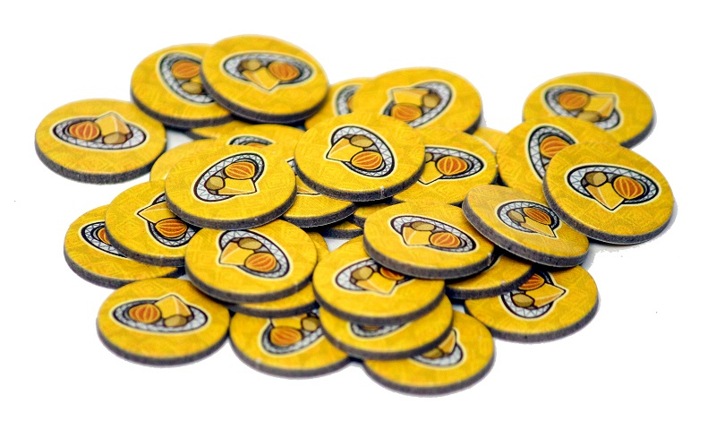 Punchboard fruit tokens in a pile