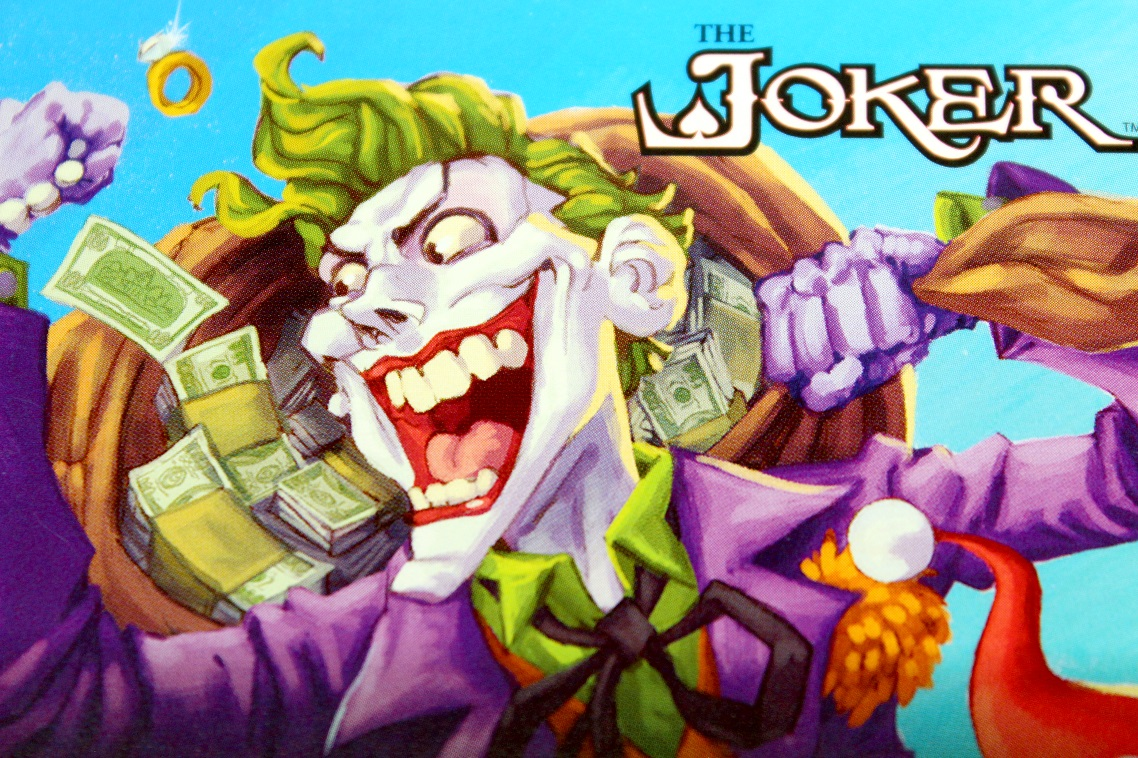 The Joker artwork with character running away with a sack of cash money