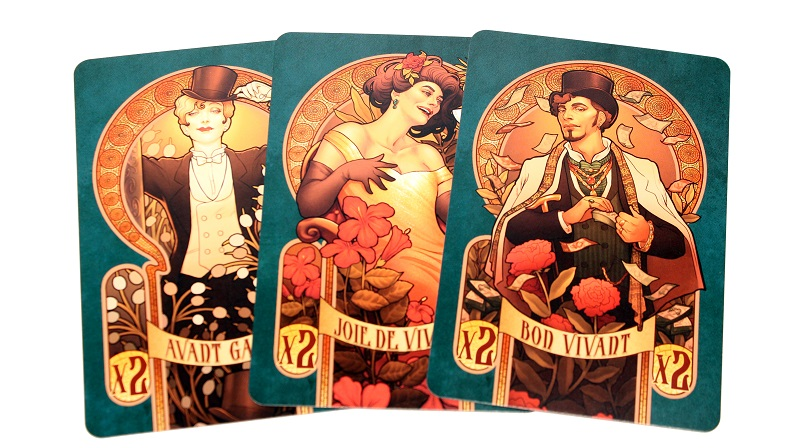 three game cards, with various illustrations depicting game characters appearing on the cardbacks