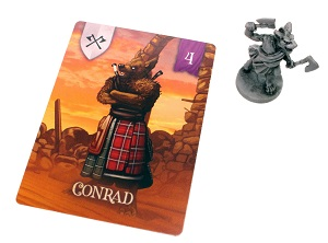 a gray miniature board game piece next to a gaming card that says 'Conrad'