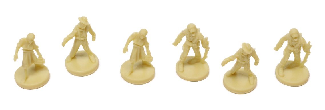 Six pale yellow zombie miniatures in a row