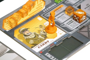 closeup of orange minis, tokens, and an orange dice placed onto the game board