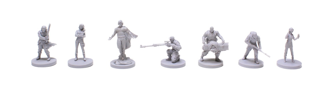 Seven unpainted plastic character miniatures displayed in a row