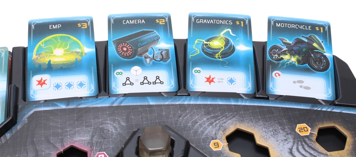 Close-up of game tray with item cards