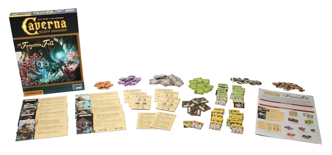 all game components laid out, including game box, rulebook, player boards, game pieces, cards and tokens