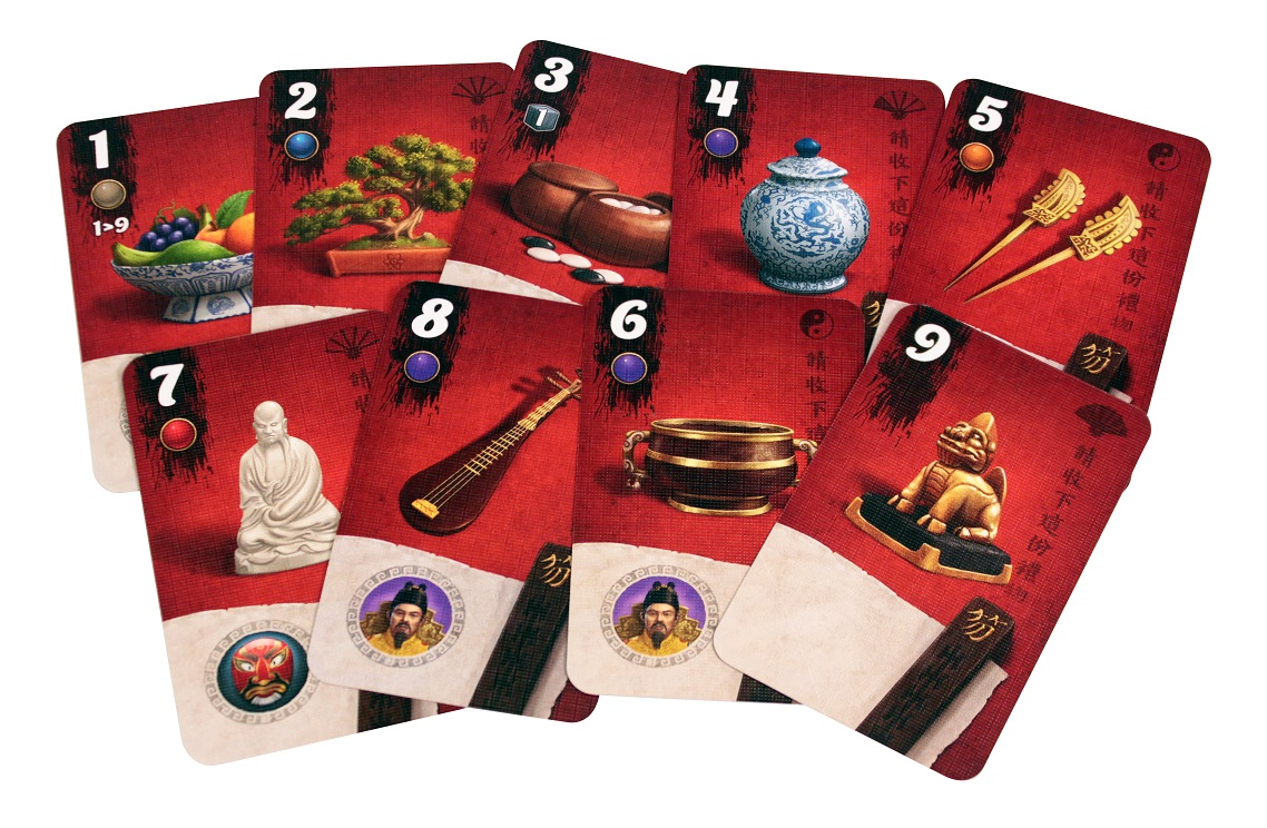 nine red game cards, each showing various numbers on their top left corner, as well as featuring images of food, instruments, and statues in the center