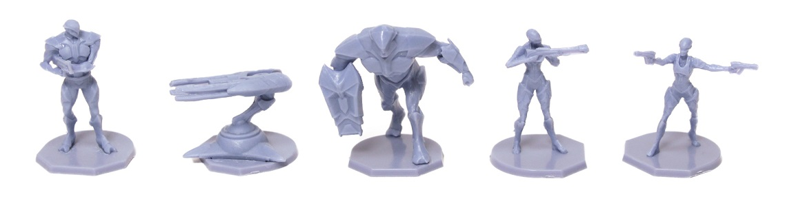 five light blue plastic game minis, including robot, ship and four character figurines
