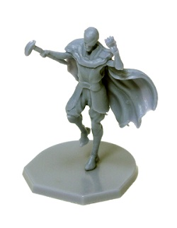 gray plastic game miniature, man wearing cape holding hammer with hand raised