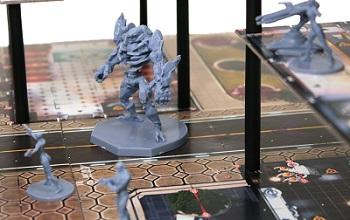 closeup of robot miniature placed upon multi-tiered game setup