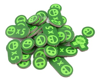 A pile of cardboard tokens featuring a stylized smiling face.