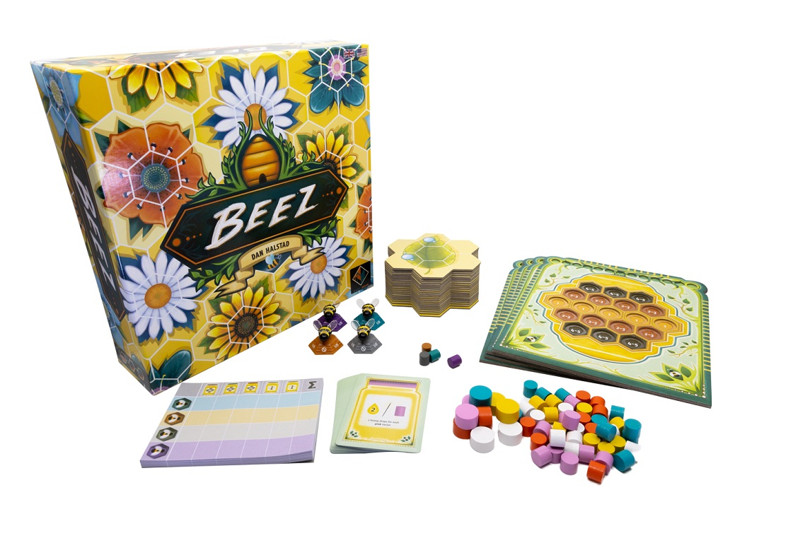 Beez components, including game packaging, cards, game pieces, and rulebook
