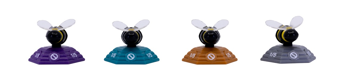 A row of four plastic Bees in different colors
