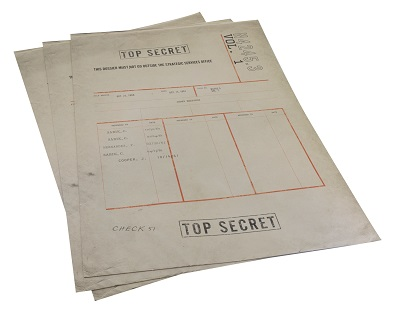 A series of dossiers with the words Top Secret plastered over them