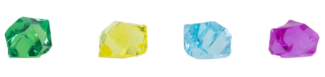 A row of four plastic gems in different colors